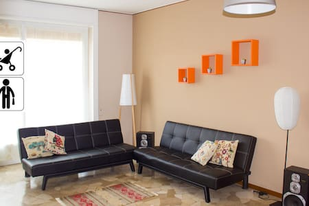 FEEL LIKE HOME ! Suited for families with children ! IMPORTANT STRICTLY Max 2 adults + 2  kids.   Metro 5 minutes Spacious apartment will welcome you in a clean and restful atmosphere. Just 15 minutes from EXPO and Milan shopping center by tube.