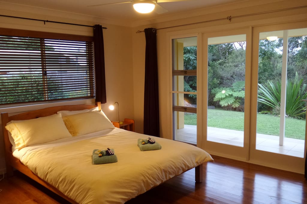 master bedroom with queen size bed and built in wardrobes
