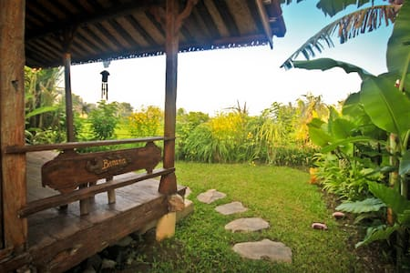 Century-old antique wooden houses brought over from remote villages in Java, decorated with beautiful carvings, 100% recycled teak wood. All balconies are facing the rice fields, with its own private outdoor garden and attached semi open bathroom.