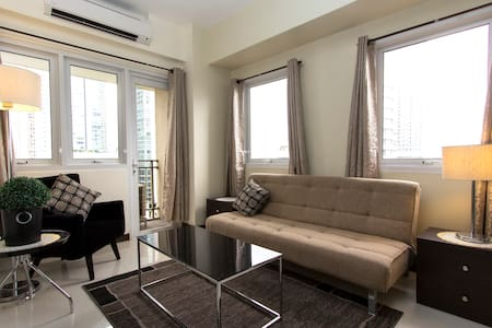 Stylish 1BR unit very near Shangrila & Megamall - Appartement