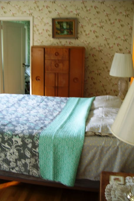 High Boy Wardrobe  lovely landscape painting and queen bed, view to ironing room...