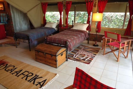 One of our six suites in our beautiful tented camp Anga Afrika, located in Karen, the unique suburb of Nairobi.  Perfect for nature lovers, this camp provides a warm, cosy and extraordinary atmosphere, which takes you away from the big city hassle.