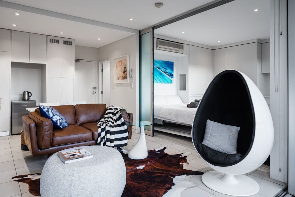 Brand new leather sofa and designer egg chair