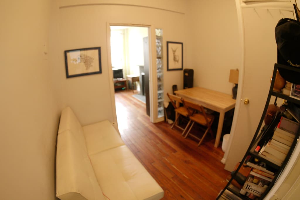 View of the small share living room/office space. There is a closet in here for more clothing storage