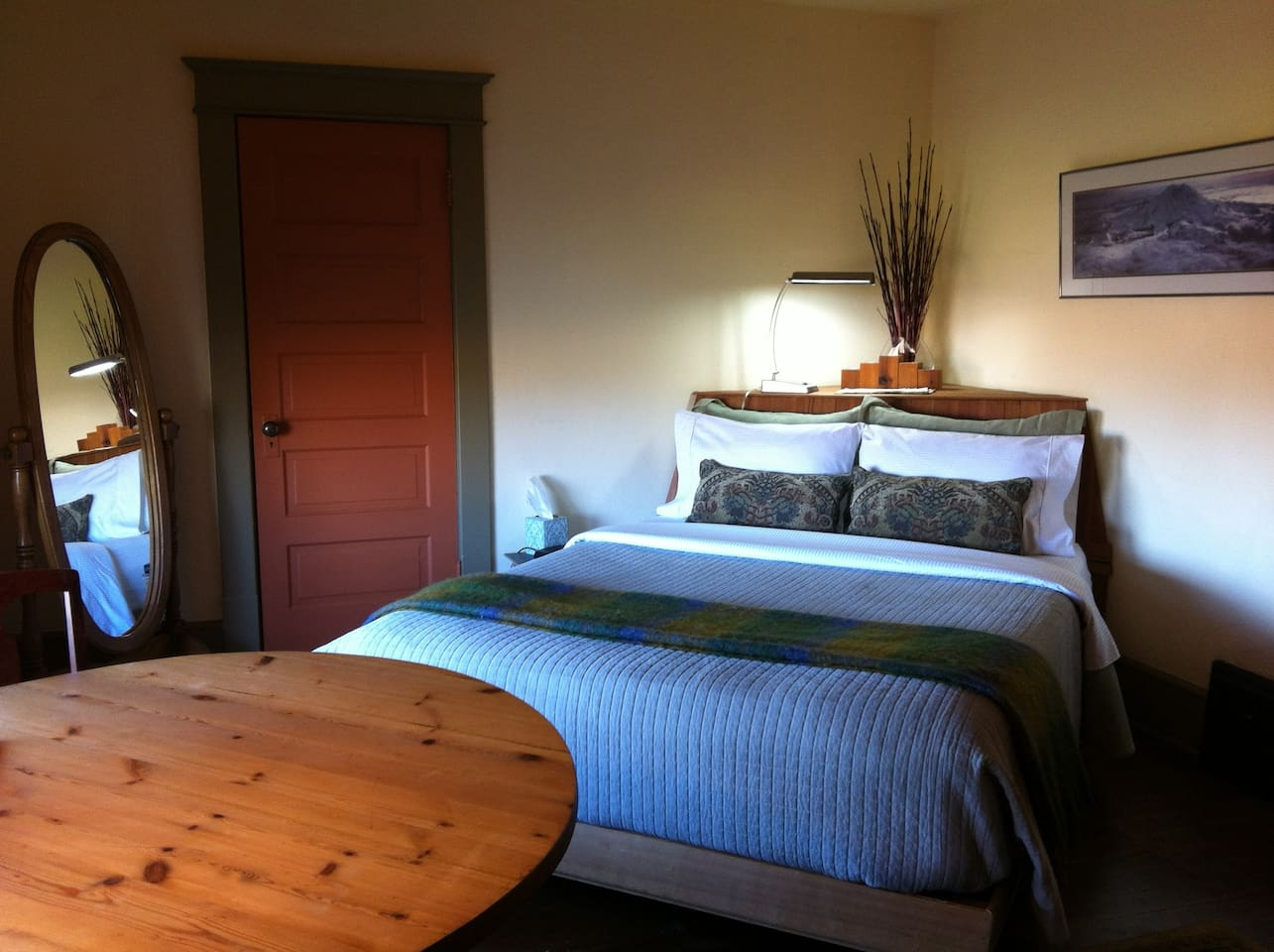 The North room bed has a built in headboard made from a recycled barn.
