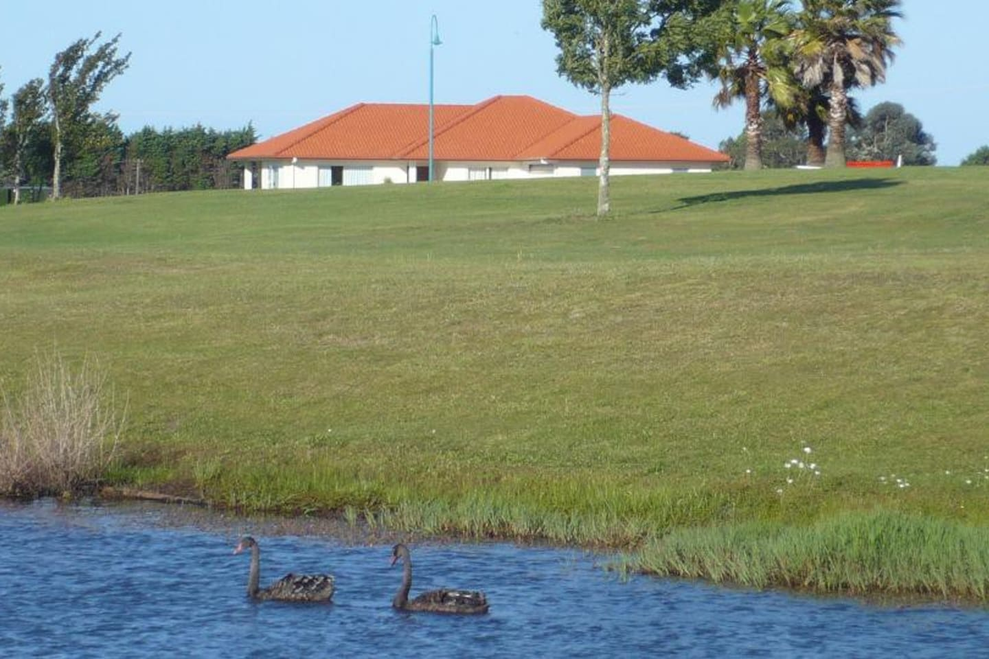 A view of our home from one of the lakes on the golf course.