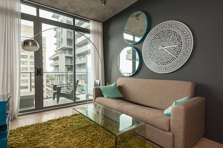 In the heart of the fashion district in downtown Toronto a luxury 1 bedroom, a spacious living room & fully equipped kitchen with TV , Internet ,Washer & Dryer. Hop to King St. W. and Bathurst and you are in the middle of the action.