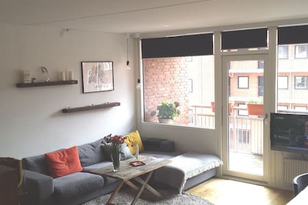 Our 74m2 spacious apartment is located in Frederiksberg in Copenhagen. It has nice bedroom, WC/shower and a big combined fully equipped kitchen and living room with sofa corner. A big and sunny balcony, funitured during spring/summer. 100 Mbit WiFI.