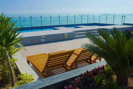 ENTIRE APT near AIRPORT ★SEA VIEW - Brand New★ - San Miguel