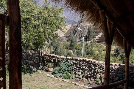"A quaint 4 room Bed and Breakfast uses the foundations of an Inca Building to to set the tone for your stay in ""The Living Inca Village''. Breath taking views of the ruins on all sides and a lovely garden are made complete with fast Wi Fi. Clean."