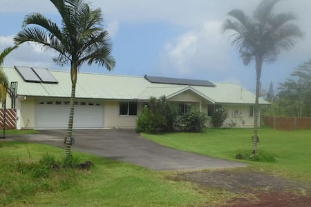 This cozy room with full size bed is situated in the country surrounded by lush greenery. Access a huge bathroom with tub, full kitchen and lanai with BBQ grill overlooking an expansive yard. Experience true relaxation in this family-friendly home.