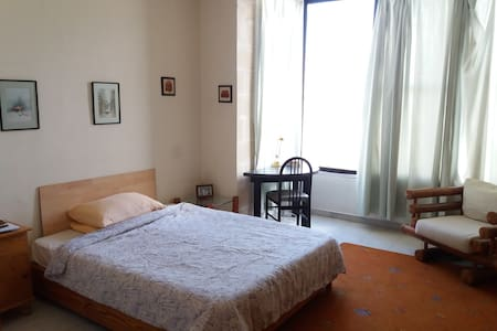 A double bedroom with private bathroom in Sliema - Il-Gżira