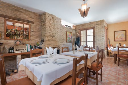 Beautiful apartment with fireplace and pool located midway between Granada and the ski resort of Sierra Nevada, for a quiet break in the countryside with wonderful views place has everything you need for your stay