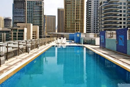 Bedroom in Spectacular Duplex - Dubai Marina - Appartamento