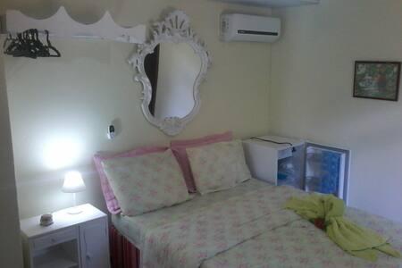 Suite 3 tripla com ar em Penedo RJ - Casa