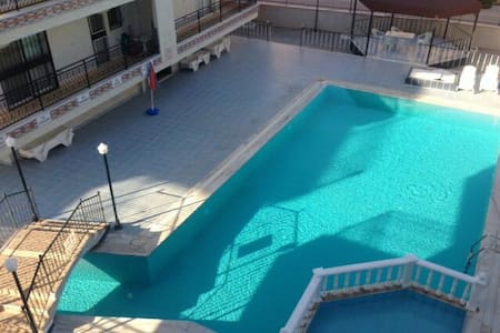 Lovely apartment with large pool - Apartment