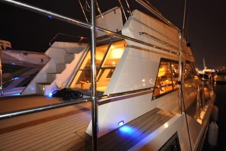 Luxury motor cruiser, Poole Quay. - Boat