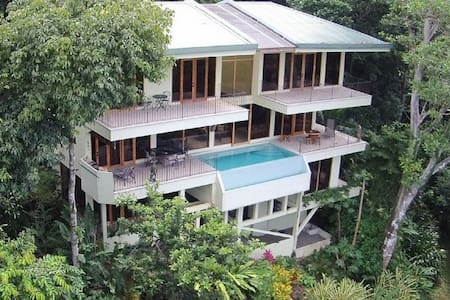 Casa Mogambo rests on one of the only true expansive estates located in the heart of Manuel Antonio. Surrounded by three acres of primal rain forest, this incredible home was designed to take in the close ocean views. (enormous gourmet kitchen)