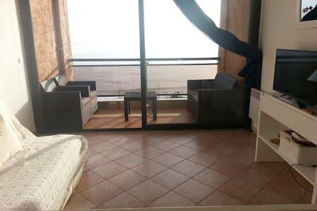 Bel appartement au bord de la mer - Condominium