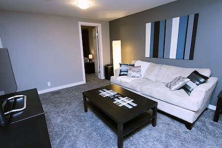 This newly renovated suite is fully furnished with 2 double beds and cots if needed. Just 10 minutes to down town by car. Bus to the c-train close by. All amenities near by. Just 2 hours to Banff.  Full cable and Internet. Very cozy space.