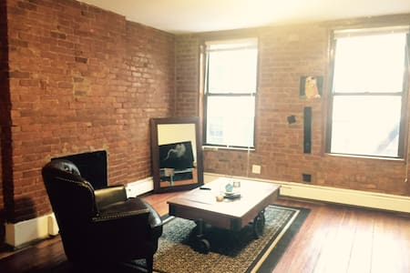 Charming 1BR Exposed Brick SoHo Apt