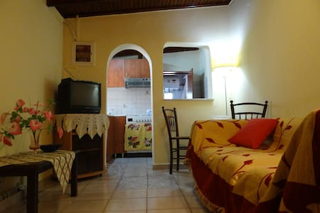 Independent apartment being accessible from the airport.  Transport from/to the airport is included in the free amenities. The apartment is a 4 minute drive from the airport.  Free internet access.  Please indicate apartment C when communicating.