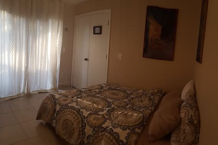 Bedroom w/ bath and patio access - North Lauderdale - Townhouse