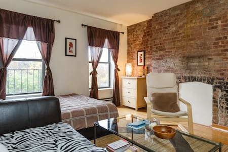 My apartment is extremely unique and located on one of the most coveted streets in the East Village. I just had my entire space renovated. Beautifully refinished decorative fireplace, two huge closets & exposed brick. Overlooking the park!!