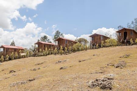 Hermosas cabañas con vista al embalse de Guatavita - Kisház