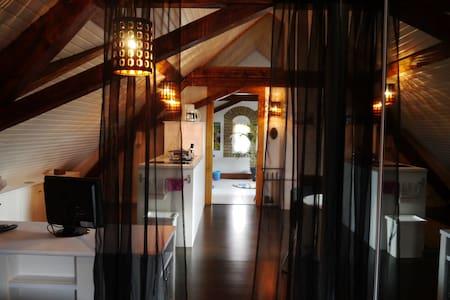 Loft sous les combles - Huis