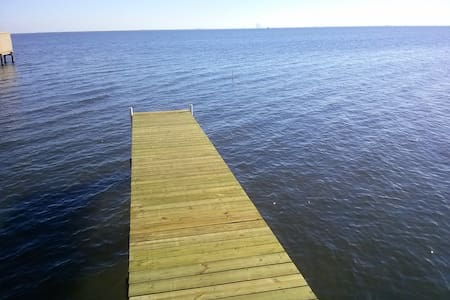 Directly on the Indian River.