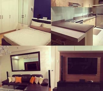 A cozy 1BR The Grove Rockwell Pasig - Appartement