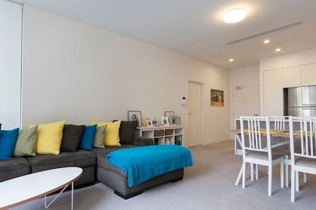 Queen room with en-suite in a brand new apartment in the quiet suburb of Rosebery which is a short 15 minute bus ride to the central.    There is secure parking available at an extra cost of $10 per day payable on arrival