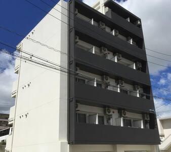 那覇新都心近1R(501) デザイナーズマンション 閑静な住宅街でゆっくり過ごせます。無料Wi-Fi - Naha-shi