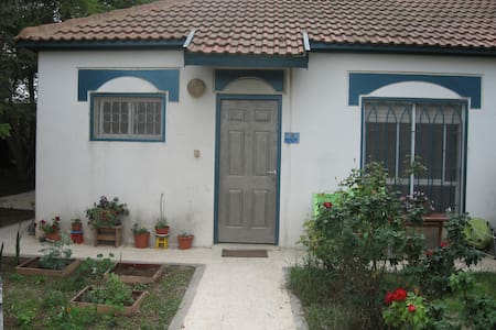 A cute little house with a garden - Talo