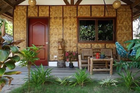 Tiki bungalows and bar's Native hut - General Luna