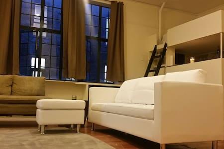 Bright comfy artist studio.