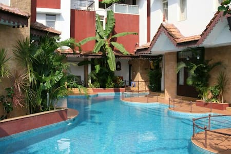 Fully AC Villa located in a serene corner of village Guirim. As you just step out of your room you step in the Lagoon pool. Villa is equipped with all modern  amenities. LCD television, kitchenette, microwave, hot/cold water, parking and security.