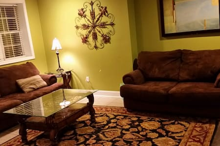 Experience Peace and Serinity in Large Basement Apt attached to large home. Quiet neighborhood  with scenic mountain views. Off street parking. Private entrance. Coffee maker, microwave,  refridgerator and dishes.