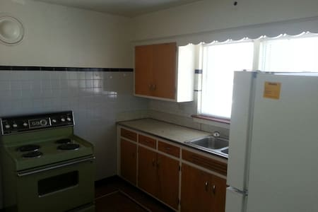 Room and TV - Two Bedroom Apartment - Hus