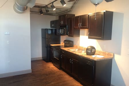 Unique modern apt located in the heart of Old Town (Wichita's Entertainment District).  Walking distance from Wichita's highly decorated entertainment venue-Intrust Bank Arena.  Makes a great spot 4 experiencing Wichita's nightlife, come be my guest.