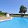 Communal area with swimming pool and garden with private access to the beach.